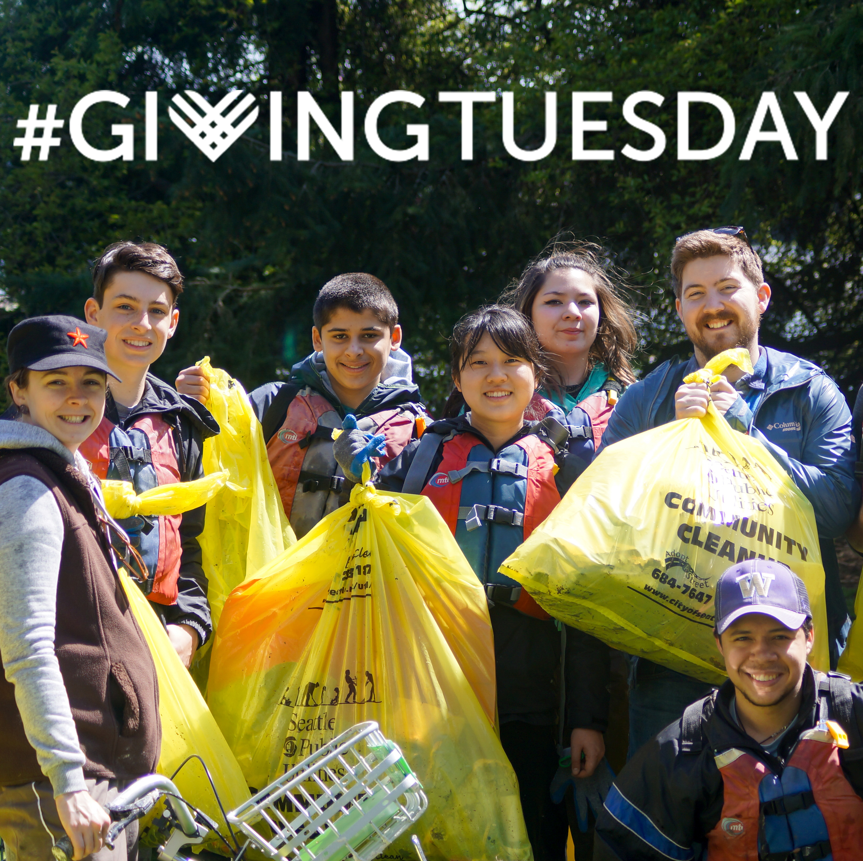 The Giving Tuesday logo appears over an image of volunteers at a cleanup holding trash bags and smiling at the camera.